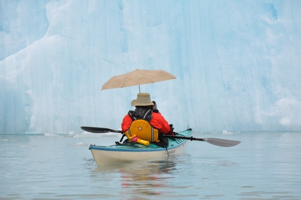 See ancient icebergs from the perspective of a kayak